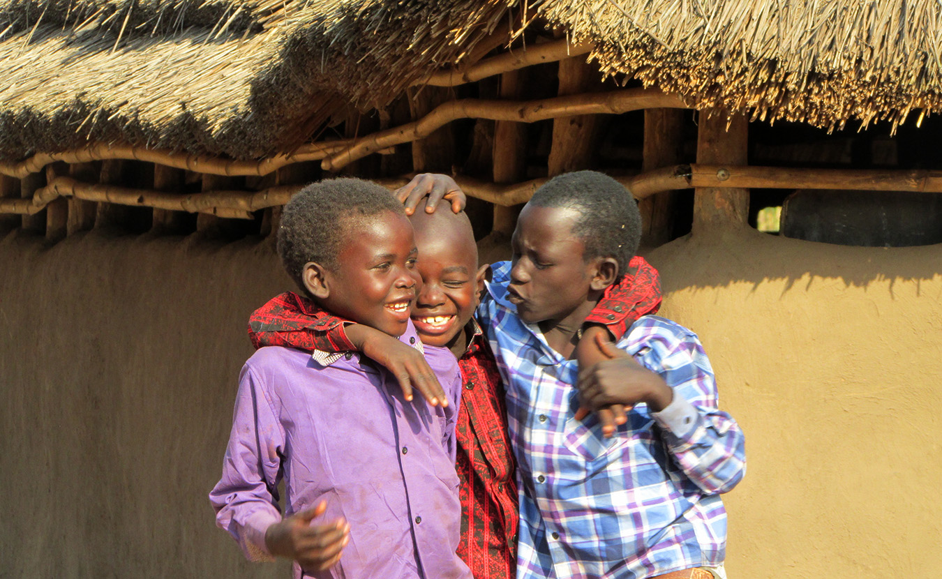 Young Moru boys playing after Christmas celebration at church. | Photo by Will and Theresa Reed