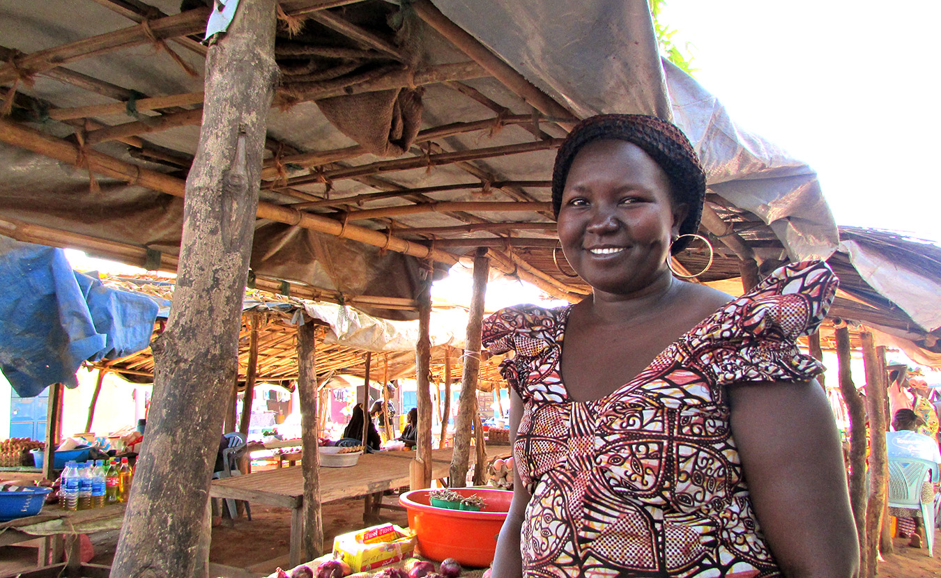 Mary, Theresa's language helper, at her booth at the Mundri market. | Photo by Will and Theresa Reed