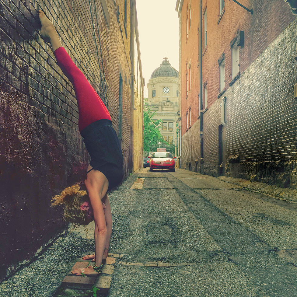 "Asanas, or postures, such as this handstand, ""allow us to practice integrating all of the limbs. Working toward a goal — being present in the posture, content with all that arises mentally and physically — is yoga."" 