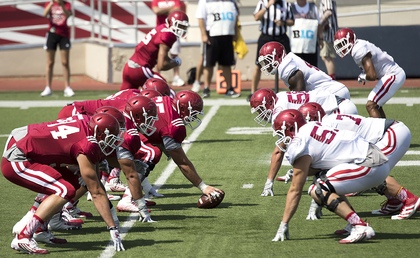 "IU football team's senior captain Nick Mangieri says the defensive front seven, shown here during preseason scrimmage against the highly touted offense, is packed with experience and has ""the attitude that we could be a top defense."" 