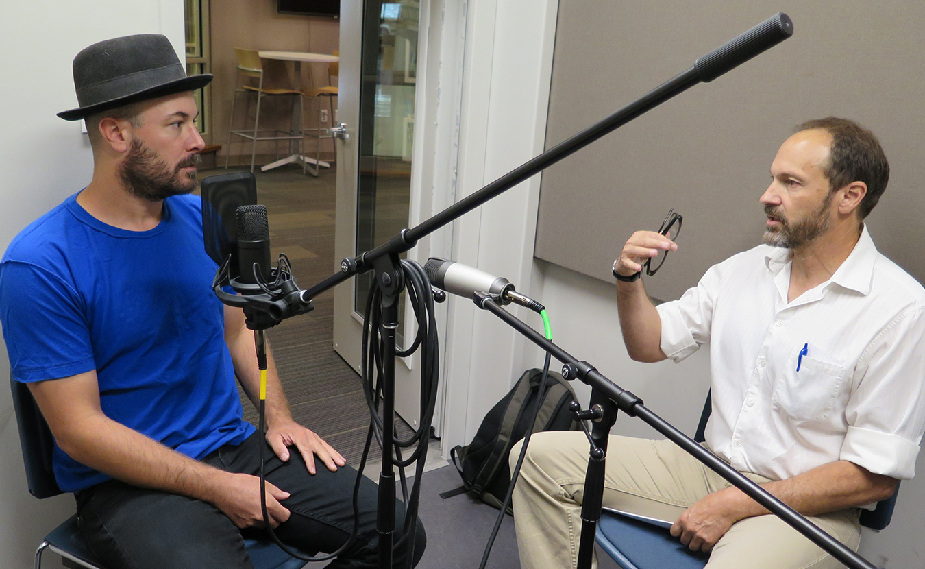 Chris Mattingly, left, tells Dave Torneo about his journey to the poet's life at the Monroe County Public Library's Level Up studio. | Limestone Post