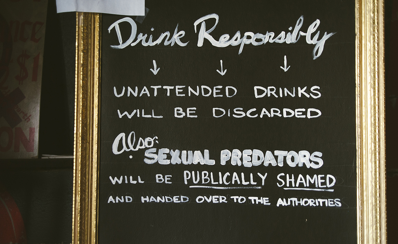 The Back Door has a variety of signs to help patrons feel more empowered to speak up if they see something going on. | Photo by Natasha Komoda