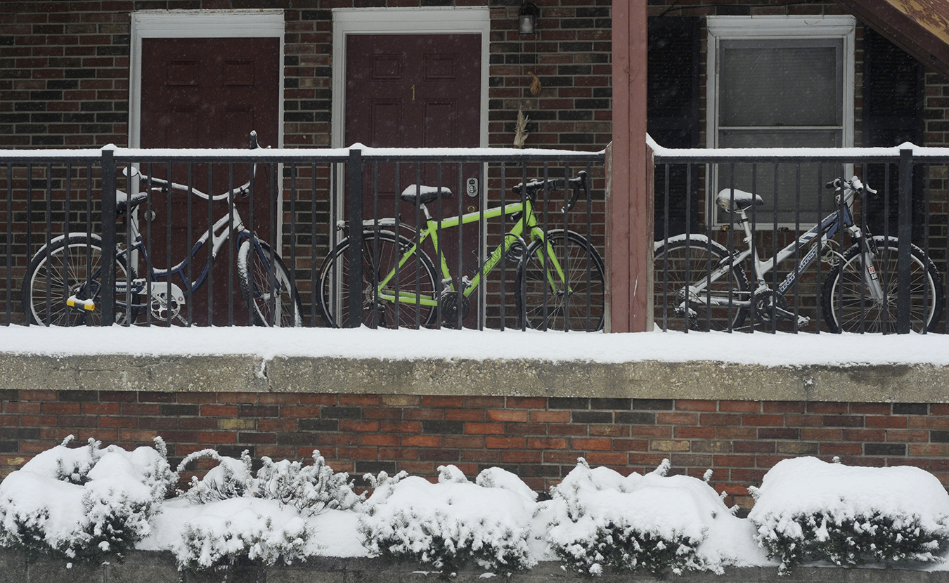 I get around Bloomington on bikes when it isn't snowing, so I was drawn to the snow-capped bikes at the apartments on East Atwater and South Woodlawn avenues. These are a bit more protected than others bikes I saw that day. | Photo by Ann Georgescu