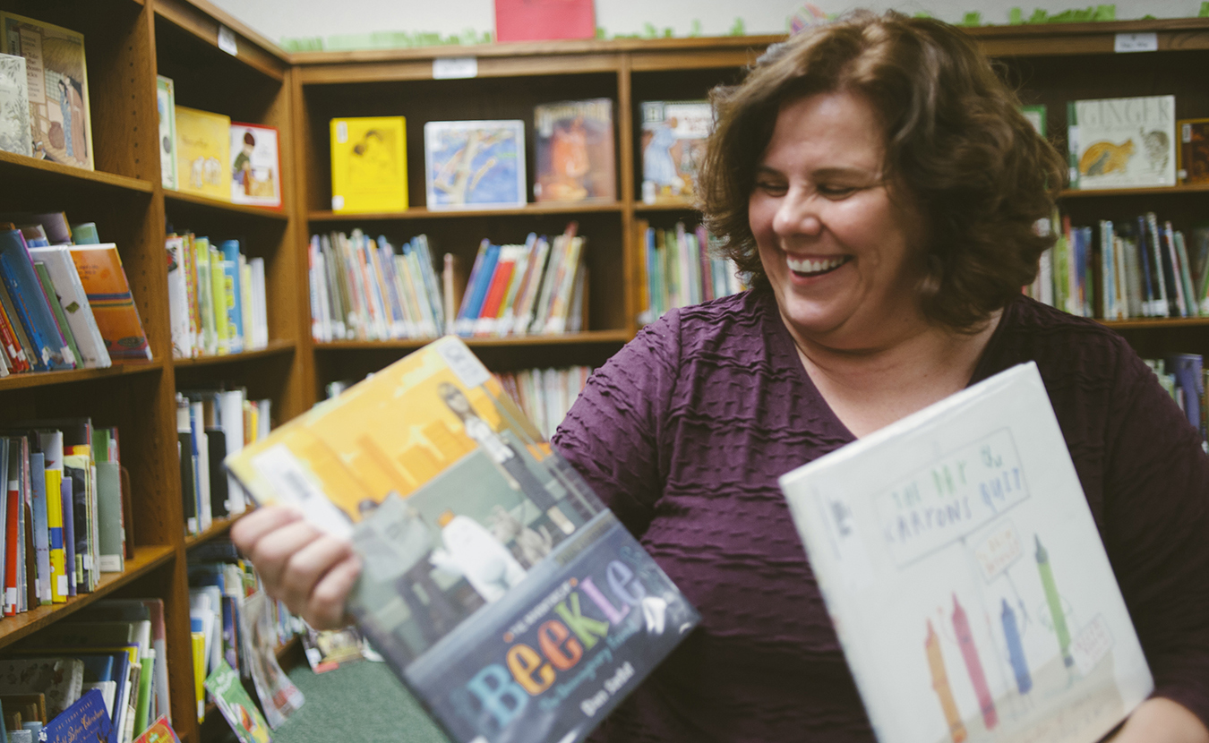 Mary D'Eliso, who has been the librarian at University Elementary School since 2004, shares some of her favorite children's books. | Photo by Natasha Komoda
