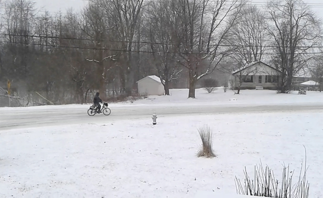 Many Monroe County residents commute to work by bike, no matter the weather. On this day in 2014, a bike commuter heads into town from the south side of Bloomington in negative-degree weather. | Limestone Post