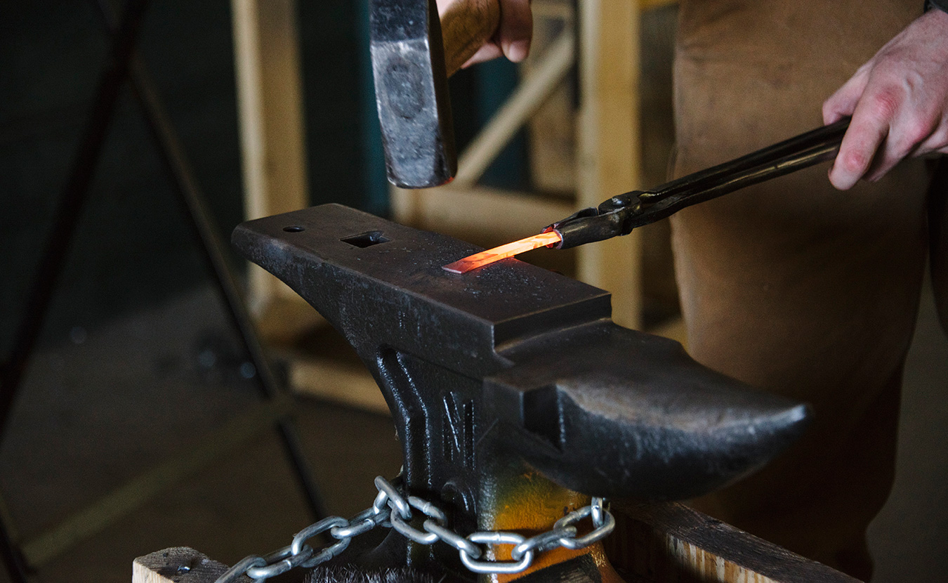 Terran Marks, resident blacksmith and owner of Brown County Forge, working in the Ingot Workshop at Artisan Alley, an artist collective on South Rogers Street. | Photo by Natasha Komoda