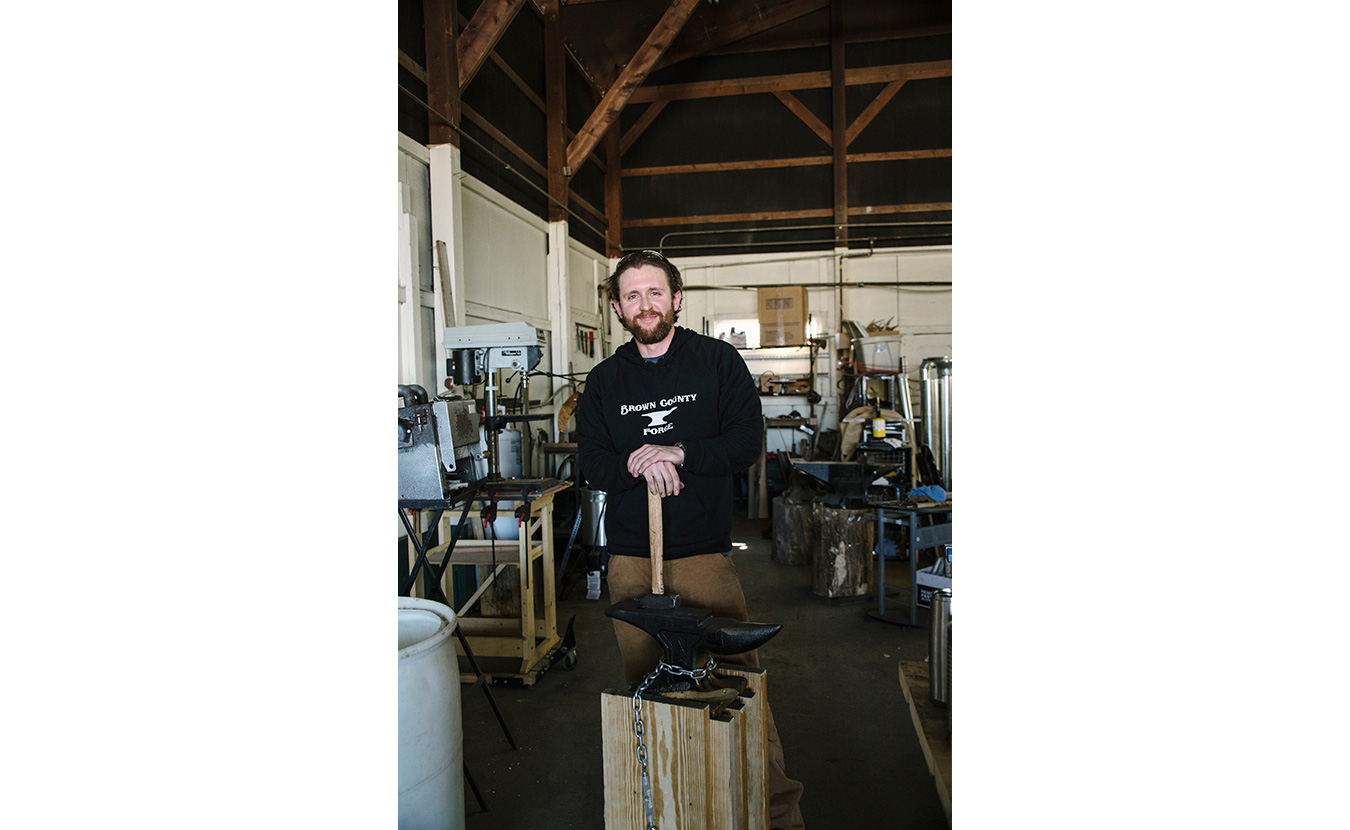 Terran Marks, resident blacksmith and owner of Brown County Forge, in his studio. | Photo by Natasha Komoda