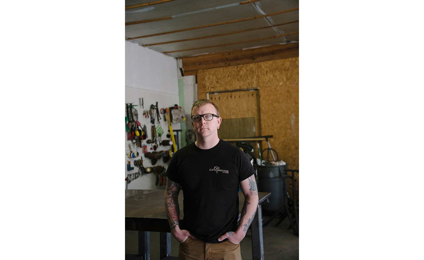 Josh Smith, owner of Clutch Fabrication & Design Studio, in his space at Artisan Alley. | Photo by Natasha Komoda