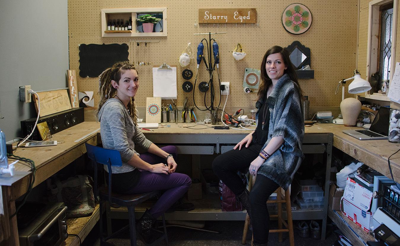 Jewelers Jenn Matthews, left, and Jessica Miller in their studio, Galactic Merkaba.   Photo by Natasha Komoda