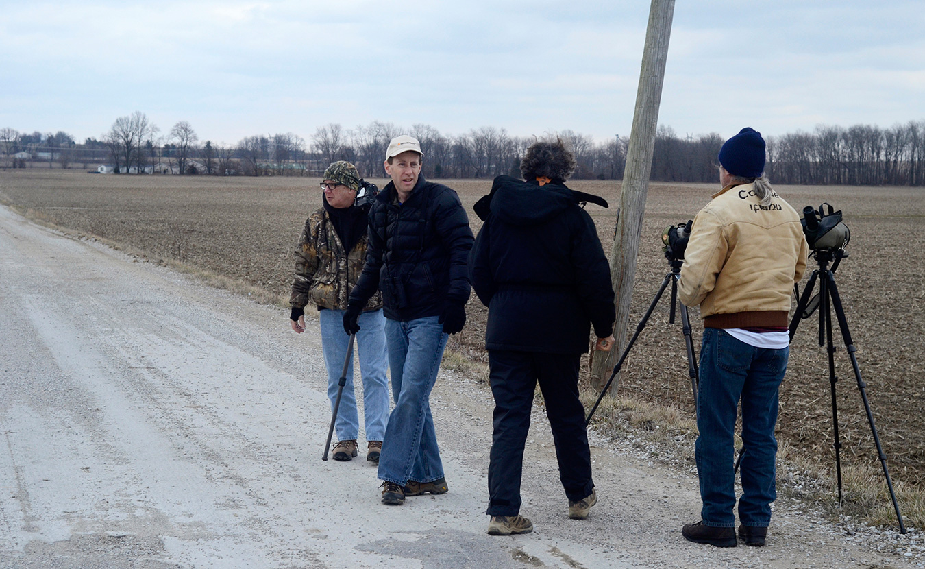 David Rupp (second from left), the owner of IndiGo Birding Nature Tours, shares his knowledge of birds and the area with everyone from fellow birding experts and photographers to novices on their first birding adventures. | Photo by Lynae Sowinski