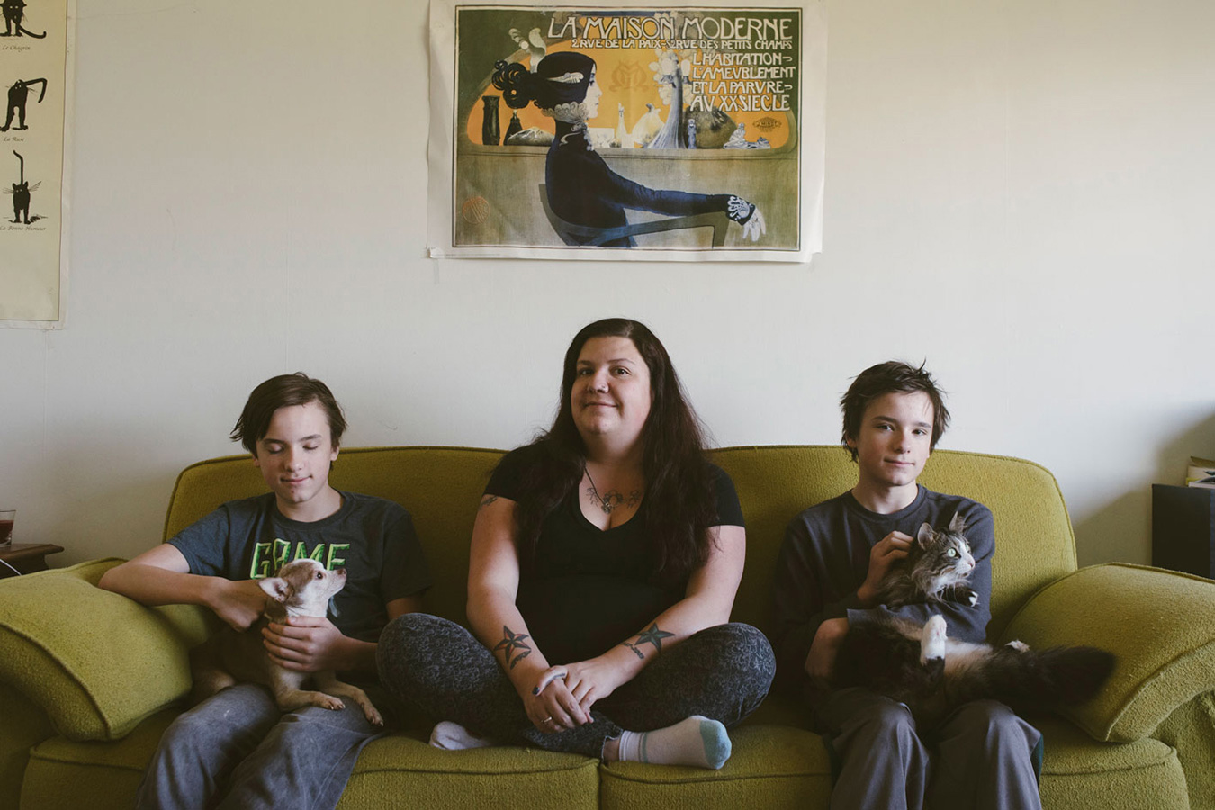 Laura Reagan sits with her twin sons, Korbyn (left) and Jarek, and their dog, Sancho, and cat, Gizzy. Reagan has dealt with food insecurity on and off throughout her life and has worked very hard to protect her sons from the stress of being food insecure. | Photo by Natasha Komoda