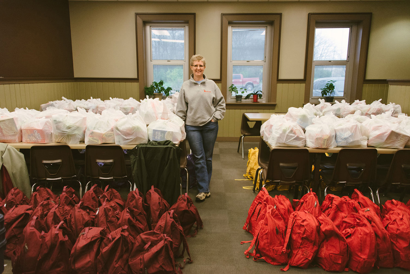 Vicki Pierce, executive director of Community Kitchen of Monroe County, oversees many programs fighting food insecurity, including sit-down meals at their South Rogers Street location and the Backpack Buddies program that sends backpacks of food home with local food-insecure children for the weekend.   Photo by Natasha Komoda