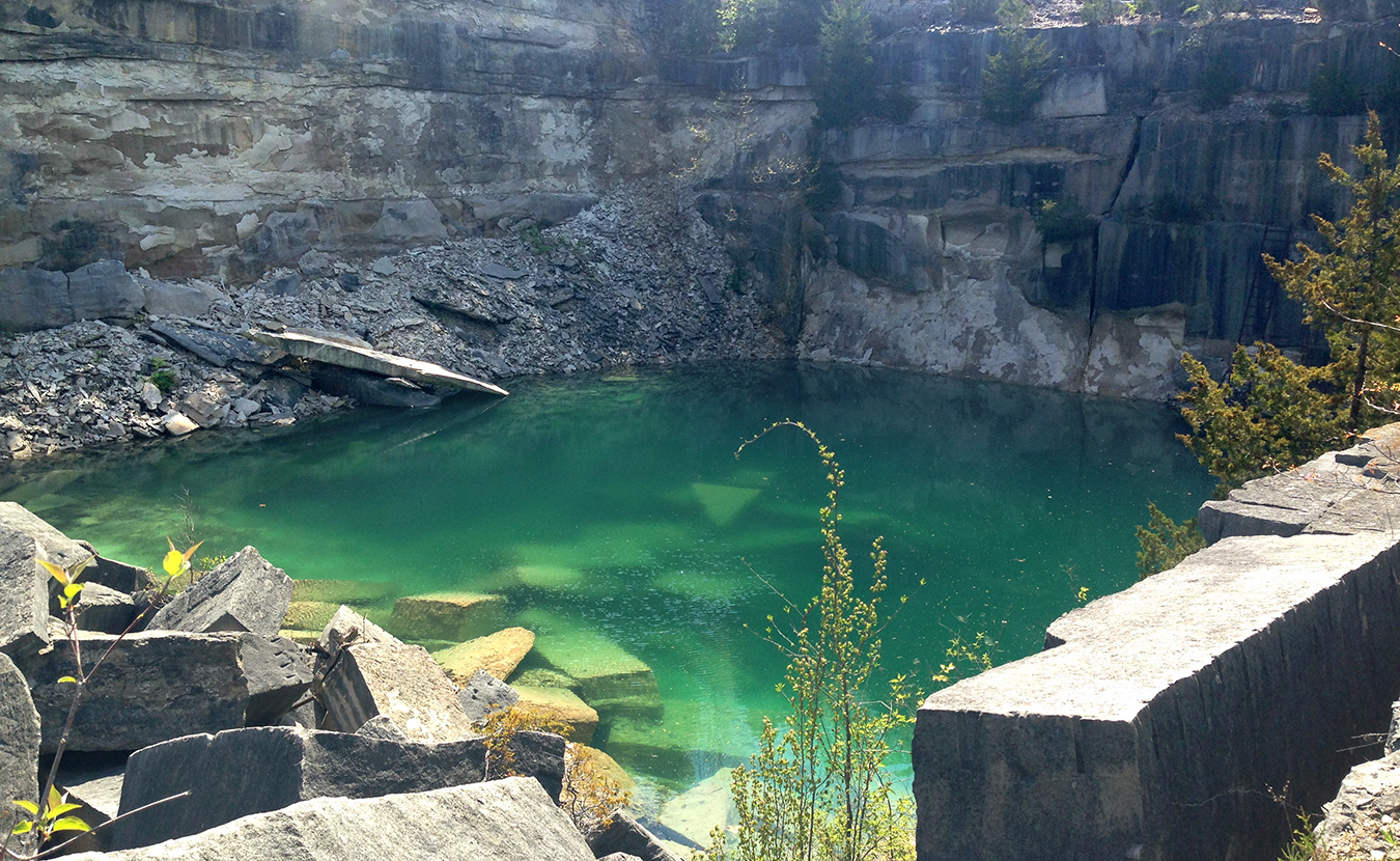 June is Indiana Limestone Month. To celebrate, there are three local quarry tours, including Furst Quarry, pictured here. | Photo by Teal Strabbing, Visit Bloomington