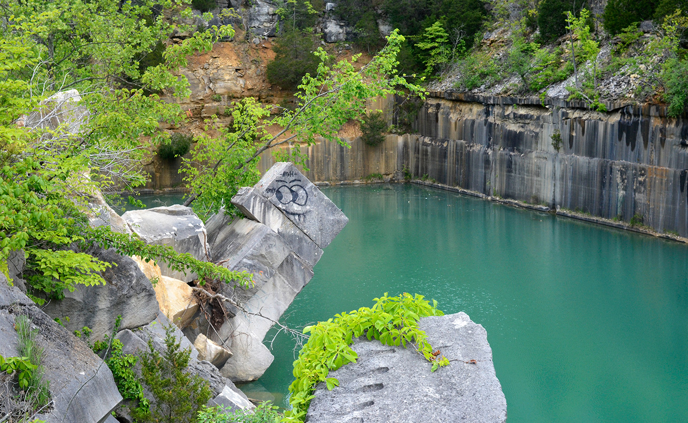 Indiana Limestone Company has considered demolishing the slab of stone, but it wouldn't stop people from jumping off other ledges and swimming in the quarry anyway. | Photo by Lynae Sowinski