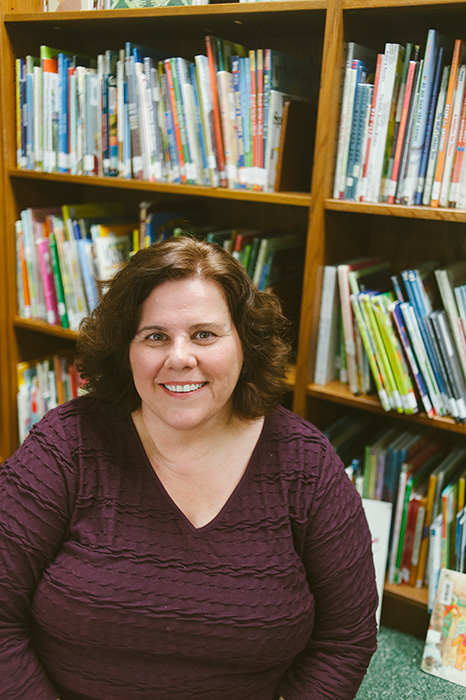 Mary D'Eliso, librarian at University Elementary School, has plenty of suggestions for good summer reads. | Photo by Natasha Komoda