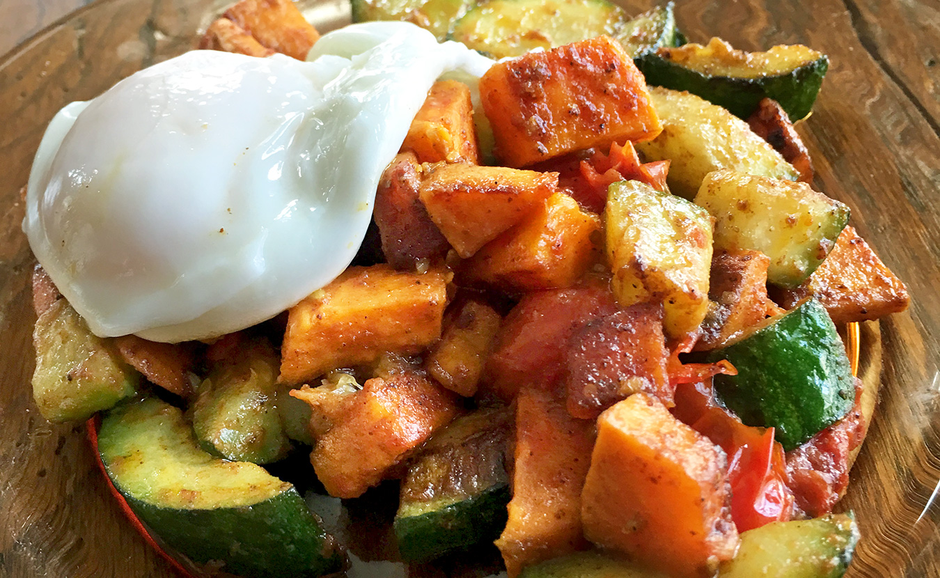 The often-ignored zucchini gets center stage in Ruthie Cohen's Zucchini and Sweet Potato Hash with Eggs recipe. | Photo by Ruthie Cohen