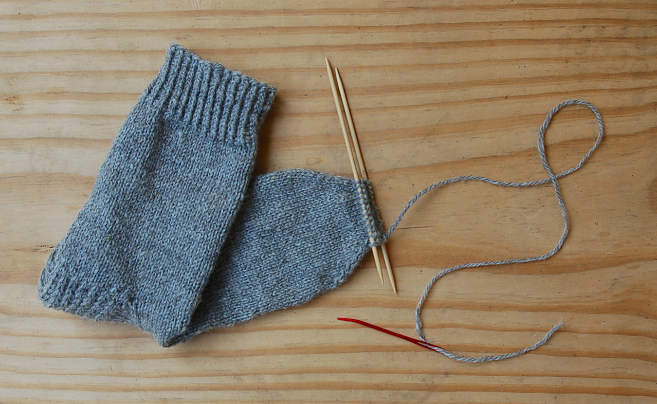 Lindsay Welsch Sveen chose to knit socks using the yarn from Marble Hill Farm's fleece crop. This photo shows the satisfying last step of sock knitting: stitching the toe closed. | Photo by Lindsay Welsch Sveen