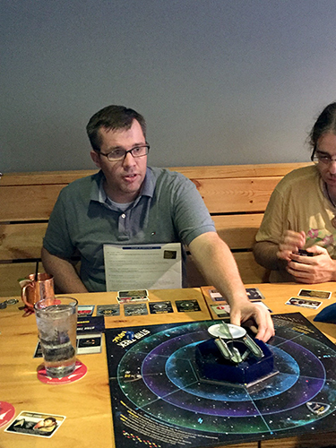 Mike Trotzke plays a game at Cardinal Spirits' Board Game Night in July. | Limestone Post