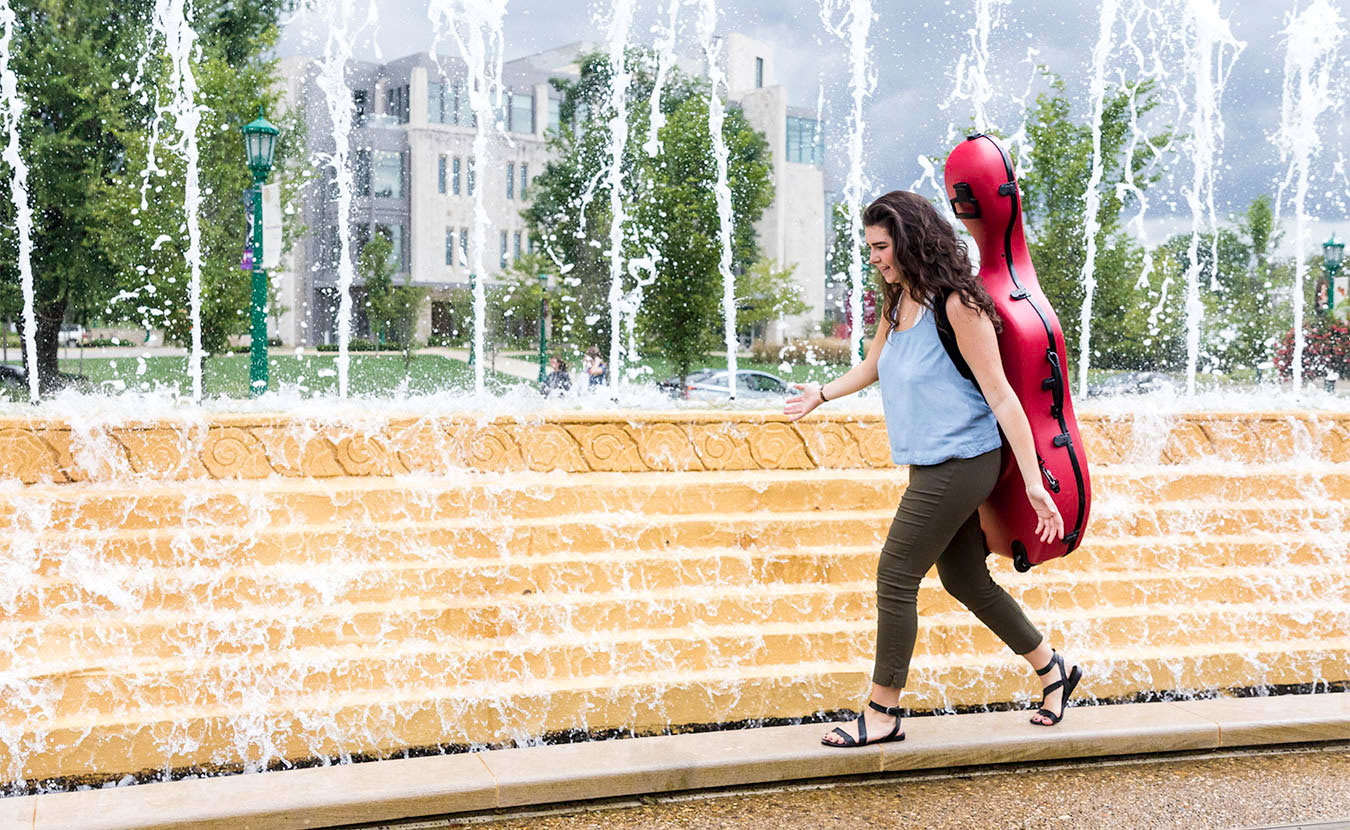 Miller Susens walks through the Indiana University campus carrying her cello. Susens is studying music education in the Jacobs School of Music and often finds herself having to defend her major. | Photo by Ben Meraz