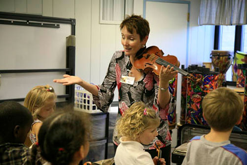 Brenda Brenner teaches violin to Fairview Elementary School students in the Fairview Violin Project. | Courtesy photo