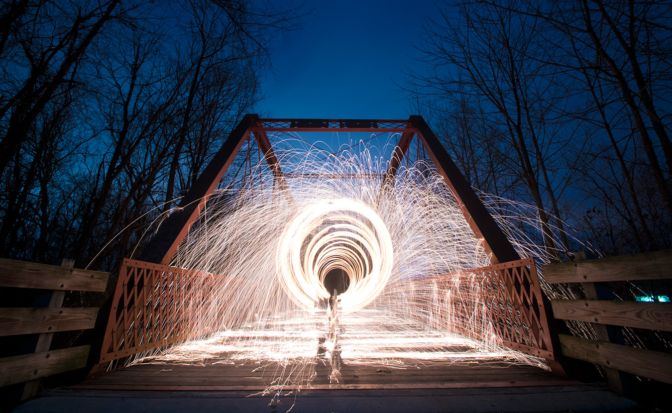 Nathan Clark spins steel wool on the Clear Creek Trail. This picture was a part of the photo gallery in