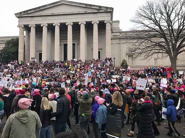 Marchers gathered on the steps of the National Gallery of Art on Saturday morning. | Photo by Lynae Sowinski