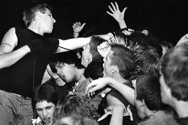 Bloomington's thriving punk scene of the '70s and '80s paved the way for today's punk bands. Pictured here, Seven Seconds performing at Ricky's Canteena, a Bloomington all-ages club, in 1984. | Photo courtesy of Mike Whybark