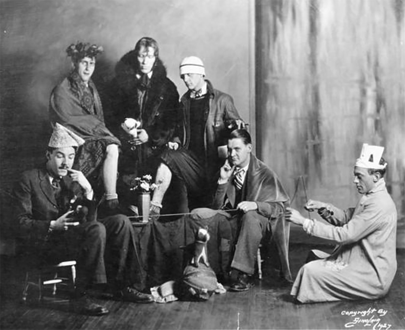 "Monk (back row, center) became the chief spokesman of a group of absurdist artists he named the Bent Eagles. Carmichael wrote on the back of this photograph: ""Some more crazy musicians from Indiana. Moenkhaus in fur collar, Eddie Wolf with bow and arrow."" 
