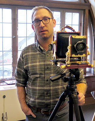 Adam Reynolds with his 4x5 field camera. | Limestone Post