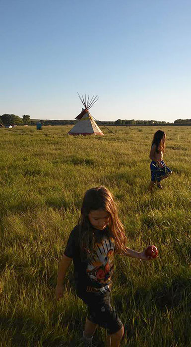 Martinez's sister, Kelly Tudor, took this photo is of her children, Ohanna (front) and Aslan Tudor, at Standing Rock in August 2016. | Photo by Kelly Tudor