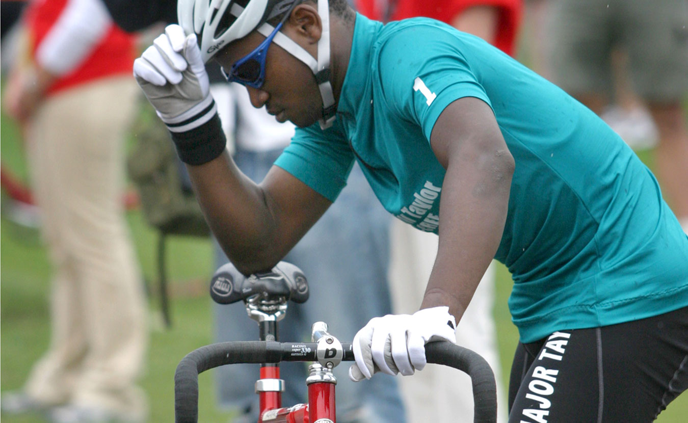 Ever since a team from a Black fraternity raced in the inaugural Little 500 in 1951, the race has had few minority participants. A concerted effort in the 2000s seemed to have broken the color barrier, with Team Major Taylor finishing as high as second place, but today the men's and women's races are nearly as white as ever. Pictured here is Team Major Taylor cyclist Simeon Commissiong prior to the start of the 2004 race. | Courtesy photo