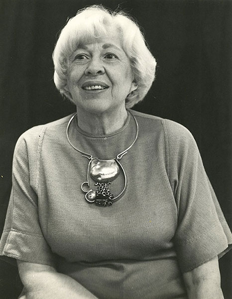 Eikerman is wearing one of her signature pieces made out of silver, green onyx, and gold. | Photo courtesy of Indiana University Archives