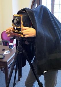 Photographer Adam Reynolds gets his large-format camera ready. | Limestone Post