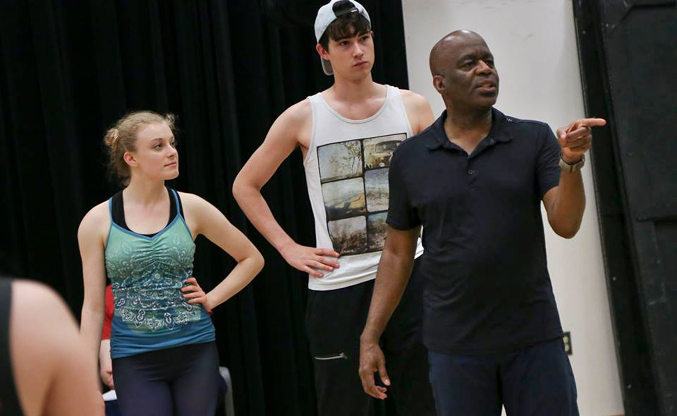 "Kenneth L. Roberson (right), director and choreographer of this summer's ""Dames at Sea"" production by Indiana University Summer Theatre, instructs during a rehearsal. 