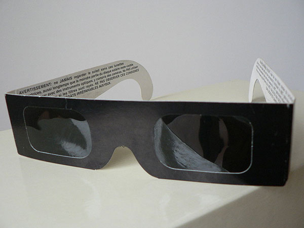 "It is dangerous to look at the sun during a partial eclipse, so make sure you have solar eclipse glasses with a designated ISO 12312-2 international standard. | Photo courtesy of <a href=""https://commons.wikimedia.org/wiki/File:Eclipsbrilletje.JPG"" target=""_blank"">Bree~commonswiki, Creative Commons</a>"