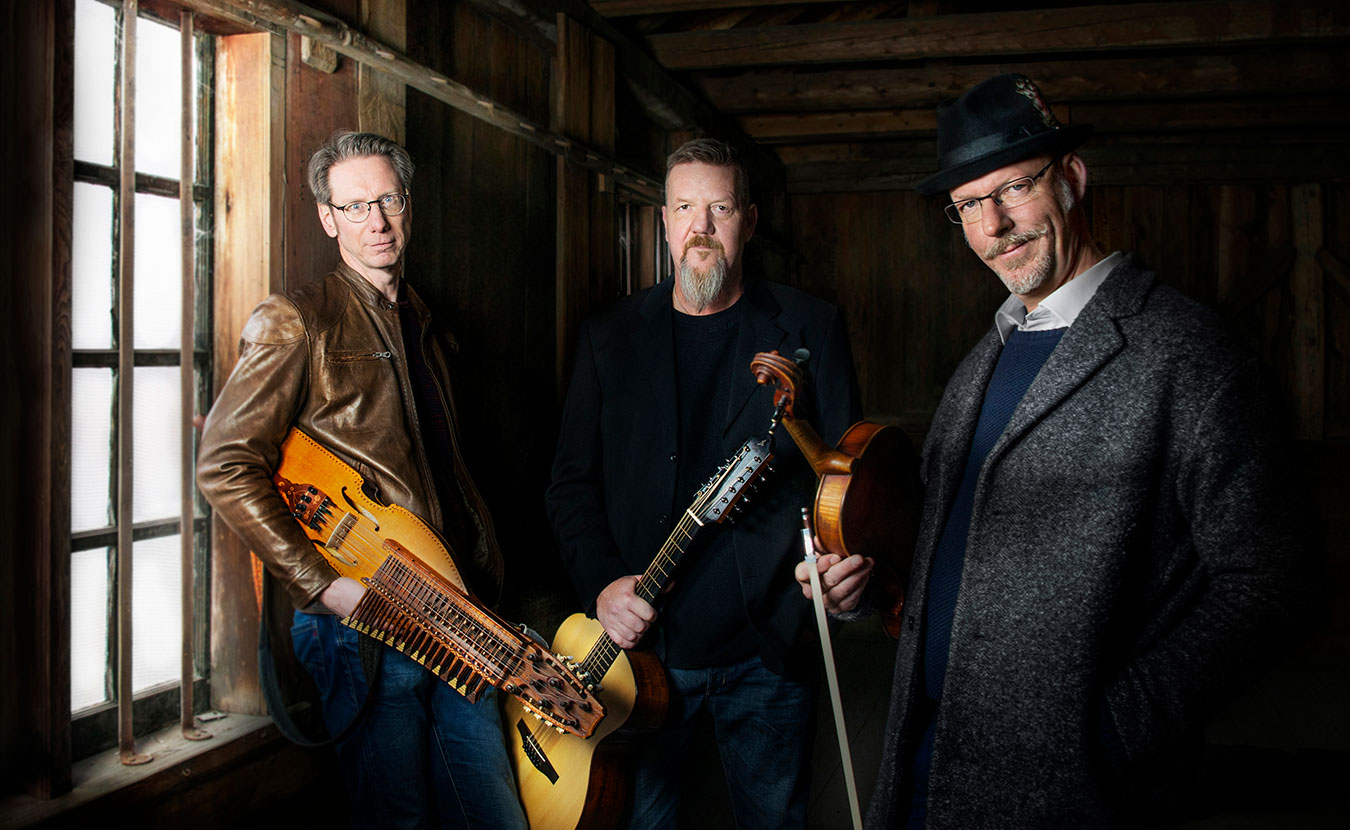(l-r) Nyckelharpa player Olov Johansson, guitarist Roger Tallroth, and violist Mikael Marin of the Swedish band Väsen will be performing at their ninth Lotus World Music and Arts Festival this year. | Courtesy photo