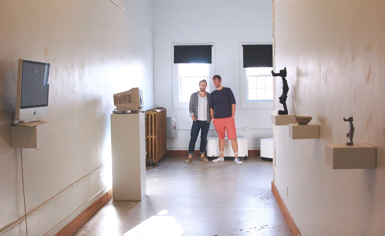"Artists William Bass, left, and Raphael Cornford stand at the end of their downtown gallery space, NOISE. Writer Lindsay Welsch Sveen says a new art scene is emerging that offers ""hip alternatives to the institutions."" 