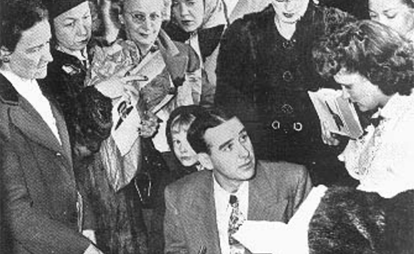 "Writer Ross Lockridge Jr. (RLJ) killed himself on March 6, 1948, just two months after his book ""Raintree County"" was published. Pictured here, RLJ is signing autographs at an L. S. Ayres department store in Indianapolis on January 20, 1948. This is the last known photograph of RLJ. 