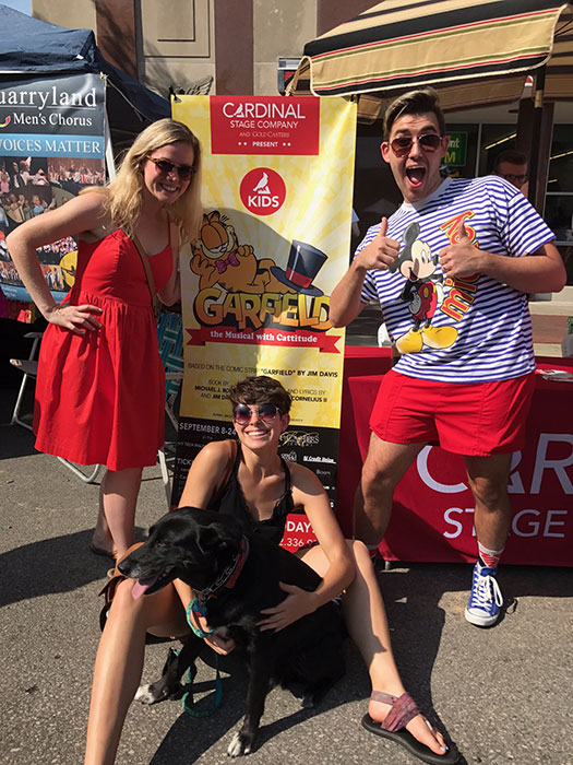 Cast members, left to right, Ashley Dillard, Anna Butler, Chris Krenning, along with a furry friend, at Pridefest on August 26.