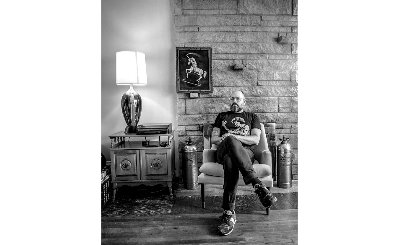 Paul Caccamo, a Ph.D. student at Indiana University, relaxes in his Bloomington home. | Photo by Adam Reynolds