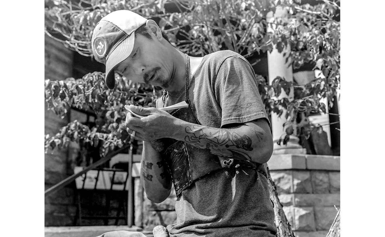 Woodworking artist Kyle Pearson demonstrates his craft at the 4th Street Festival of the Arts and Crafts. | Photo by Adam Reynolds