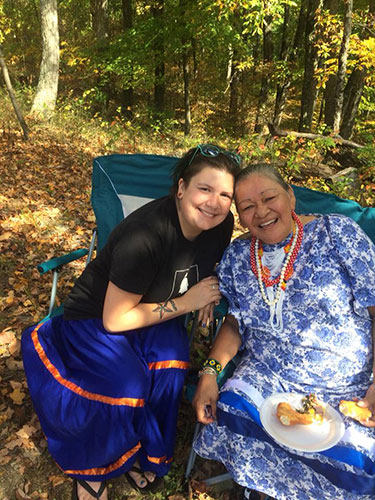 Halloween costumes perpetuate the mistaken idea that Native Americans are one homogenous culture and that they are stuck in the past. In this photo, Martinez, left, who is wearing a T-shirt with a traditional Apache skirt, sits with friend Margie King, a citizen of the Anishinaabe tribe. | Courtesy photo