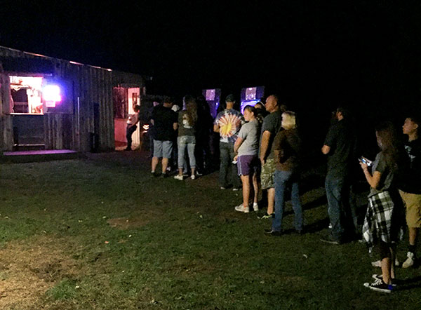 Patrons wait to enter the Barn of Terror.   Limestone Post