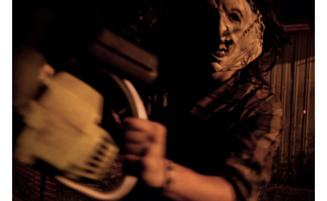 The Chainsaw Maniac at the Barn of Terror.   Photo by Adam Reynolds