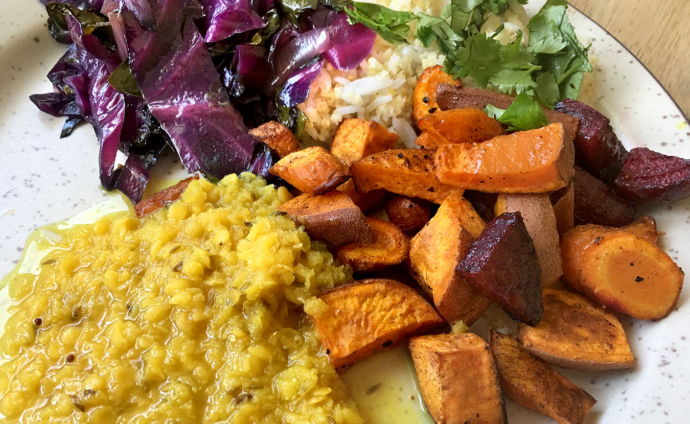 Health educator and certified Ayurvedic practitioner Kristin Londergan's roasted root veggies and red lentil dal with cabbage, rice, and millet. | Photo by Ruthie Cohen