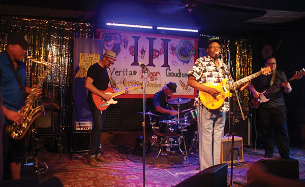 The Players Pub hosts Weekly Blues Jams every Tuesday evening. Pictured here, Bloomington blues band Fistful of Bacon performs in 2016 at the SCI Blues Society's one-year anniversary at The Players Pub.   Photo by Sierra Vandervort