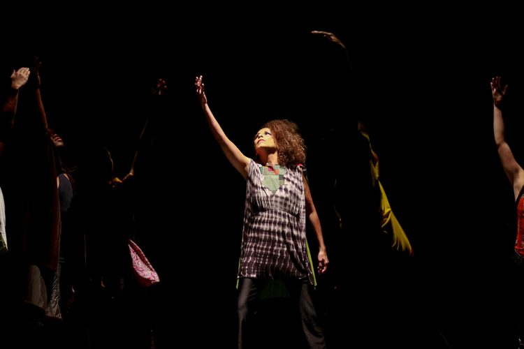 """Kim Morris Newson, center, dances with the IU African American Dance Company in their Potpourri of the Arts concert, November 11, 2017, at the IU Auditorium. She says dance is """"communication without words.""""   Photo courtesyof African American Arts Institute."""