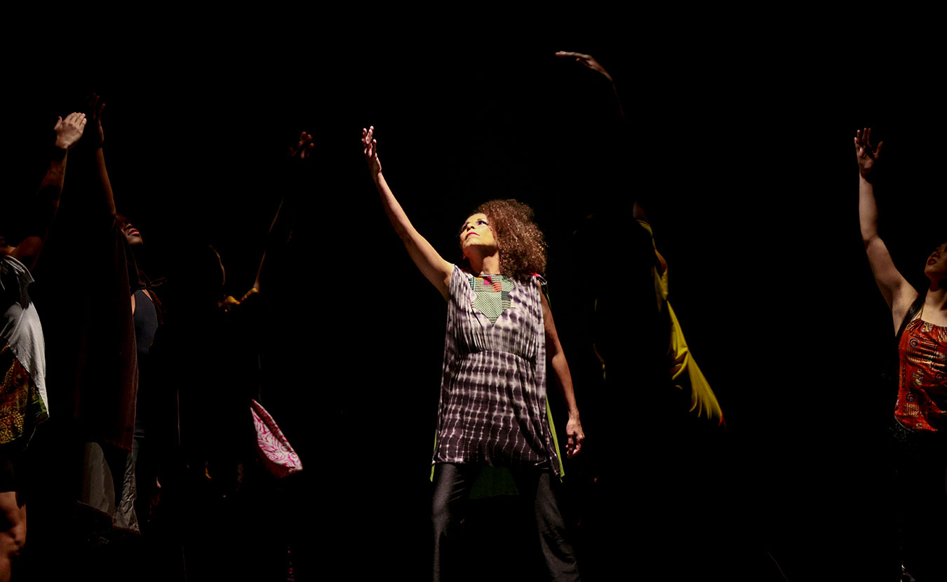 """Kim Morris Newson, center, dances with the IU African American Dance Company in their Potpourri of the Arts concert, November 11, 2017, at the IU Auditorium. She says dance is """"communication without words."""" 