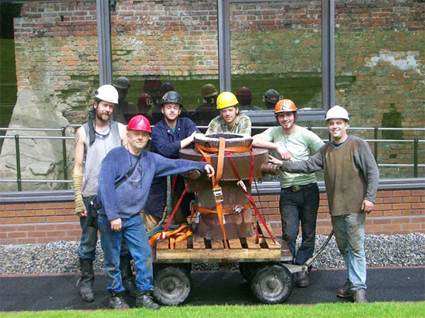 Iron casting crew in front of the historic Telford furnace in Coalbrookdale, England, at the International Conference of Contemporary Cast Iron Art 2009. From left, Chris Johns, Rick Batten, Will Vannerson, Nate Hensley, Chris Gerber, and Gerry Masse. The crew stands with Lady Dianne, the furnace they built, now in use at Sculpture Trails Outdoor Museum in Solsberry. | Courtesy photo