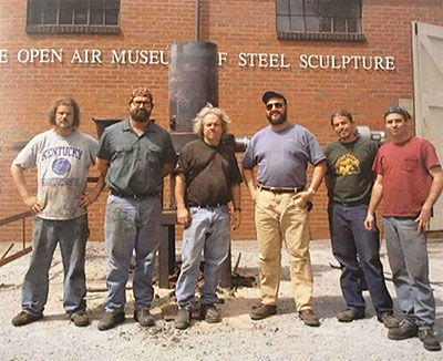 Ironmen, circa 2001. From left, University of Kentucky students Casey McKinney and Bill Rainey, Alabama Art Casting President Rick Batten, University of Kentucky Dept. of Art Chair Jack Gron, and University of Kentucky graduate students Ryan Goff and Gerry Masse. | Courtesy photo